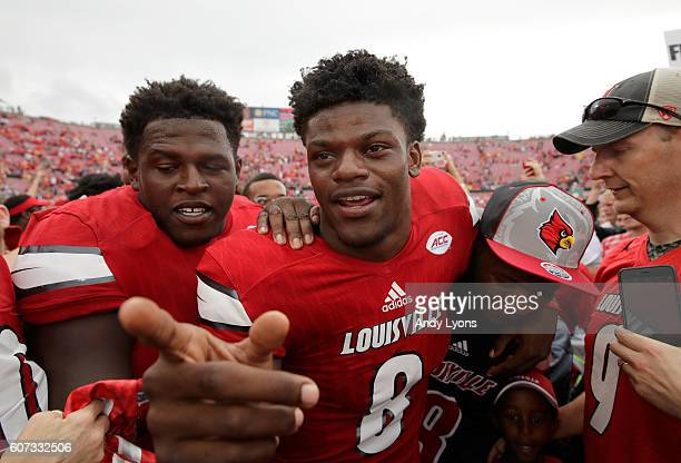 Lamar Jackson of the Louisville Cardinals celebrates with teammates after the 6320 win over the Florida State Seminoles at Papa John's Cardinal...