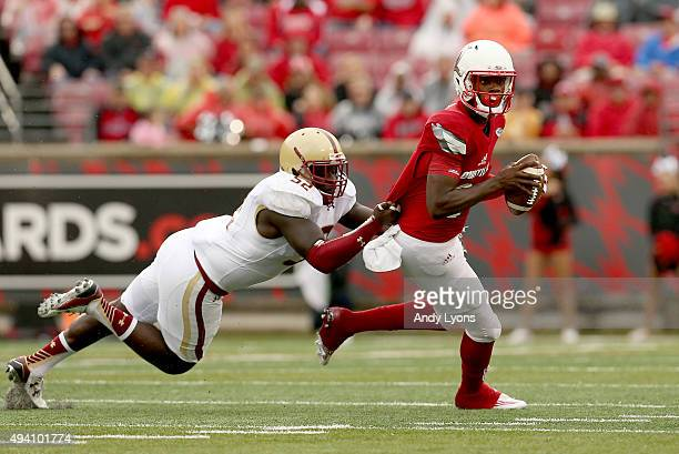 Lamar Jackson of the Louisville Cardinals is sacked by Steven Daniels of the Boston College Eagles at Papa John's Cardinal Stadium on October 24 2015...