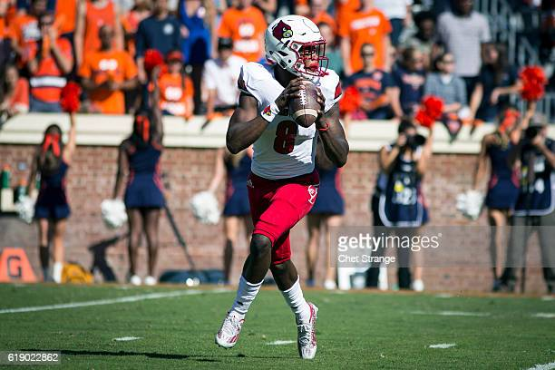 Lamar Jackson of the Louisville Cardinals looks for a pass during Louisville's game against the Virginia Cavaliers at Scott Stadium on October 29...