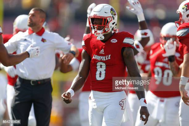 Lamar Jackson of the Louisville Cardinals looks on prior to the game against the Kent State Golden Flashes at Papa John's Cardinal Stadium on...