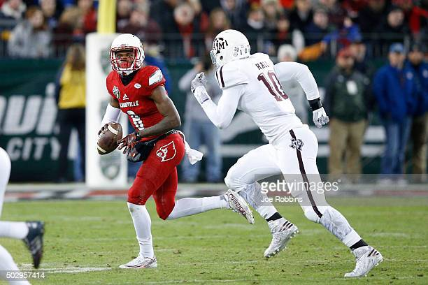 Lamar Jackson of the Louisville Cardinals looks to pass against the Texas AM Aggies in the first half of the Franklin American Mortgage Music City...