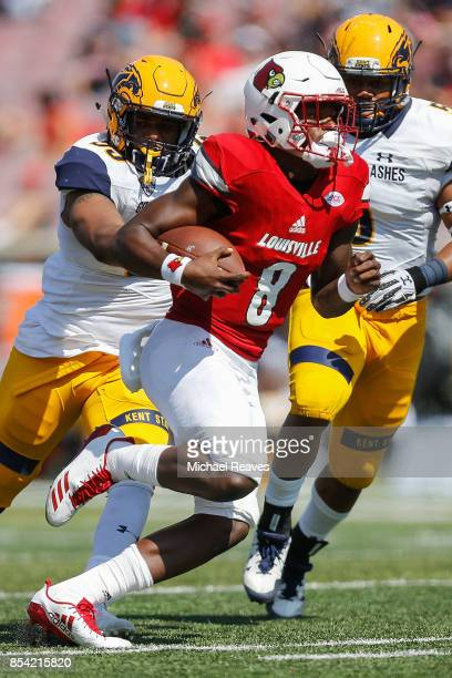 Lamar Jackson of the Louisville Cardinals runs for a first down against the Kent State Golden Flashes during the second half at Papa John's Cardinal...