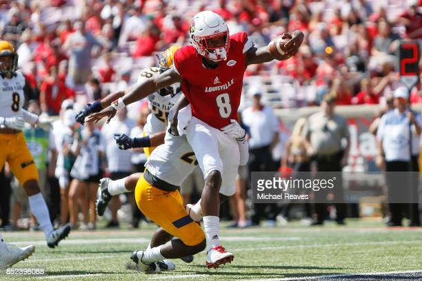 Lamar Jackson of the Louisville Cardinals scrambles into the endzone for a touchdown against the Kent State Golden Flashes during the first half at...