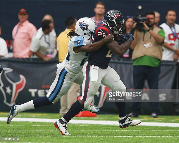 Lamar Miller of the Houston Texans is tackled by Daimion Stafford of the Tennessee Titans in the fourth quarter at NRG Stadium on October 2 2016 in...