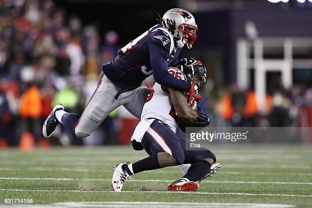 Lamar Miller of the Houston Texans is tackled by Dont'a Hightower of the New England Patriots in the second half during the AFC Divisional Playoff...
