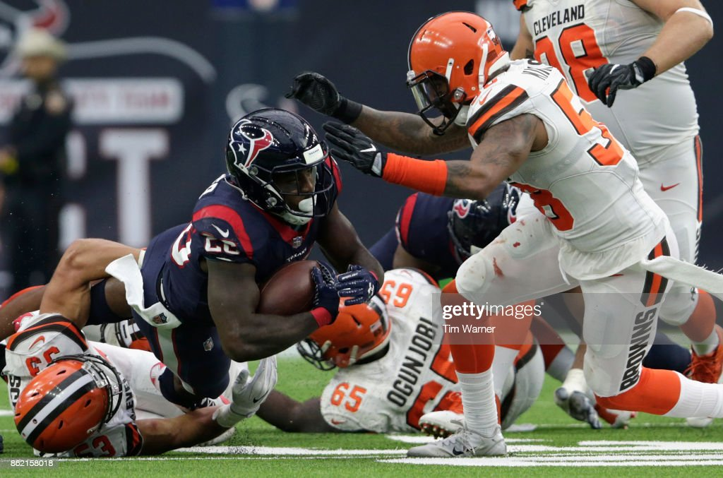 Lamar Miller #26 of the Houston Texans is tackled by Joe Schobert #53 of the Cleveland Browns in the second half at NRG Stadium on October 15, 2017 in Houston, Texas.