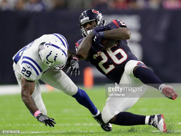 Lamar Miller of the Houston Texans is tackled by Mike Adams of the Indianapolis Colts in the fourth quarter during the NFL game between the...