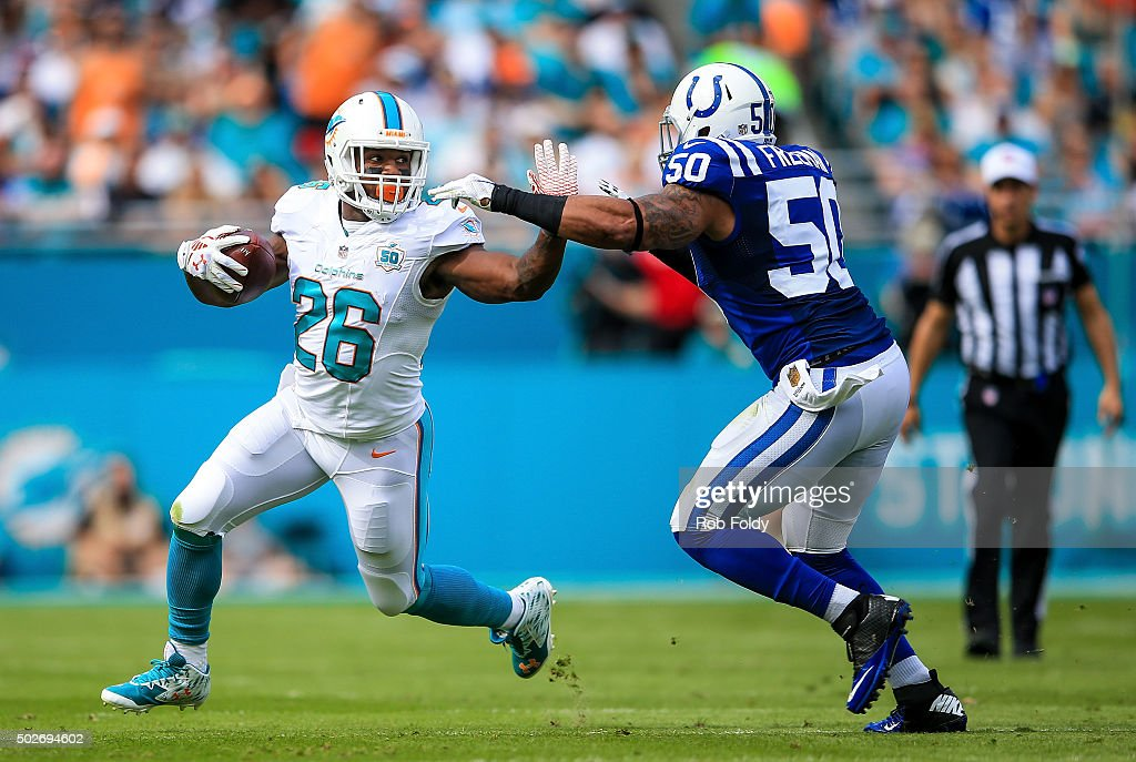 <a gi-track='captionPersonalityLinkClicked' href=/galleries/search?phrase=Lamar+Miller&family=editorial&specificpeople=7168020 ng-click='$event.stopPropagation()'>Lamar Miller</a> #26 of the Miami Dolphins is defended by <a gi-track='captionPersonalityLinkClicked' href=/galleries/search?phrase=Jerrell+Freeman&family=editorial&specificpeople=5441871 ng-click='$event.stopPropagation()'>Jerrell Freeman</a> #50 of the Indianapolis Colts during the game at Sun Life Stadium on December 27, 2015 in Miami Gardens, Florida.