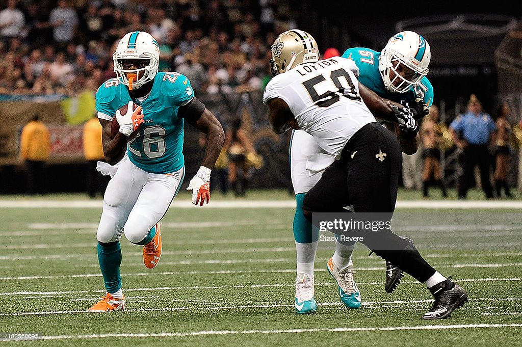 <a gi-track='captionPersonalityLinkClicked' href=/galleries/search?phrase=Lamar+Miller&family=editorial&specificpeople=7168020 ng-click='$event.stopPropagation()'>Lamar Miller</a> #26 of the Miami Dolphins runs for yards against the New Orleans Saints during a game at the Mercedes-Benz Superdome on September 30, 2013 in New Orleans, Louisiana. The Saints defeated the Dolphins 38-17.