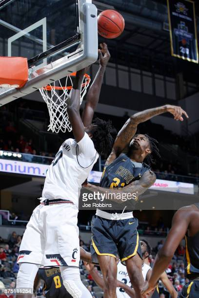 Lamar Morgan of the Coppin State Eagles blocks a shot against Mamoudou Diarra of the Cincinnati Bearcats in the second half of a game at BBT Arena on...