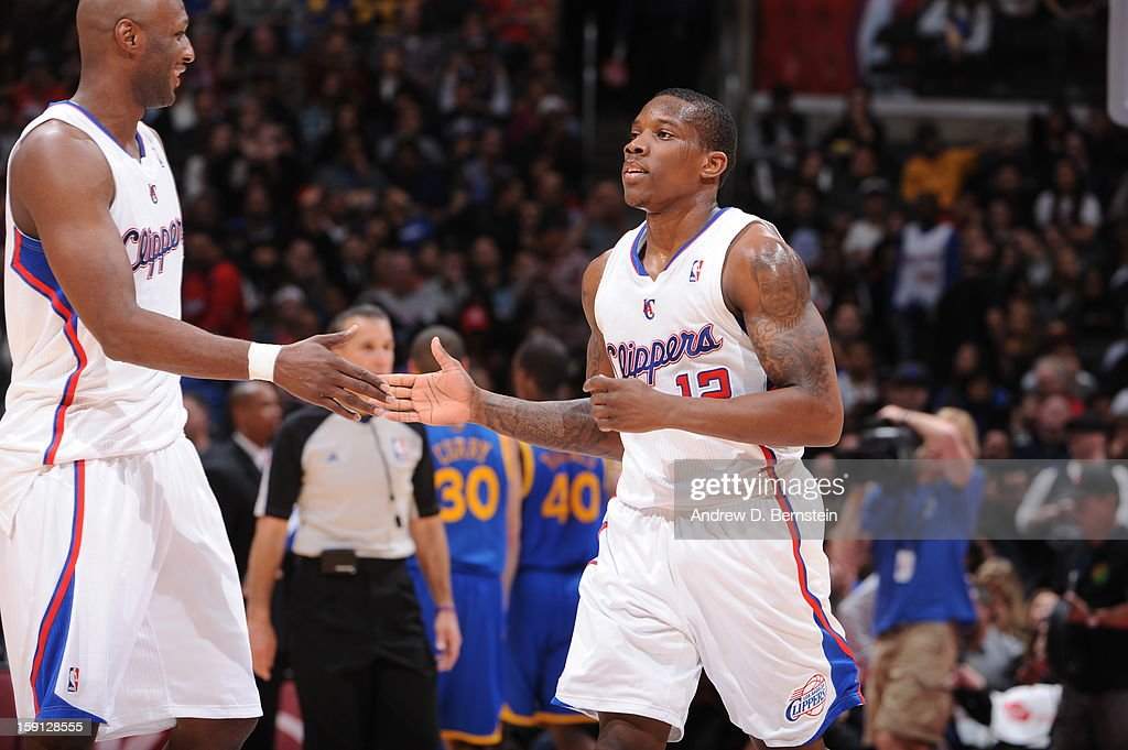 Lamar Odom #7 and Eric Bledsoe #12 of the Los Angeles Clippers celebrate a play against the Golden State Warriors at Staples Center on January 5, 2013 in Los Angeles, California.