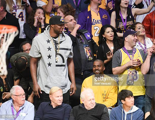 Lamar Odom and Kanye West attend a basketball game between the Utah Jazz and the Los Angeles Lakers at Staples Center on April 13 2016 in Los Angeles...