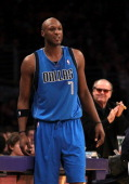 Lamar Odom of the Dallas Mavericks gets an ovation from the crowd includin actor Jack Nicholson as he enters the game against the Los Angeles Lakers...