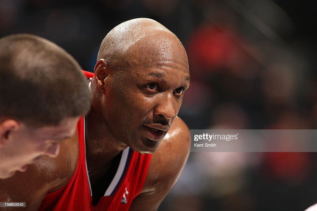 <a gi-track='captionPersonalityLinkClicked' href=/galleries/search?phrase=Lamar+Odom&family=editorial&specificpeople=201519 ng-click='$event.stopPropagation()'>Lamar Odom</a> #7 of the Los Angeles Clippers awaits a foul shot against the Charlotte Bobcats at the Time Warner Cable Arena on December 12, 2012 in Charlotte, North Carolina.