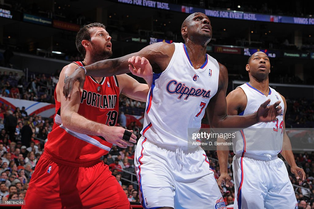 <a gi-track='captionPersonalityLinkClicked' href=/galleries/search?phrase=Lamar+Odom&family=editorial&specificpeople=201519 ng-click='$event.stopPropagation()'>Lamar Odom</a> #7 of the Los Angeles Clippers boxes out <a gi-track='captionPersonalityLinkClicked' href=/galleries/search?phrase=Joel+Freeland&family=editorial&specificpeople=757235 ng-click='$event.stopPropagation()'>Joel Freeland</a> #19 of the Portland Trail Blazers during a game at Staples Center on April 16, 2013 in Los Angeles, California.