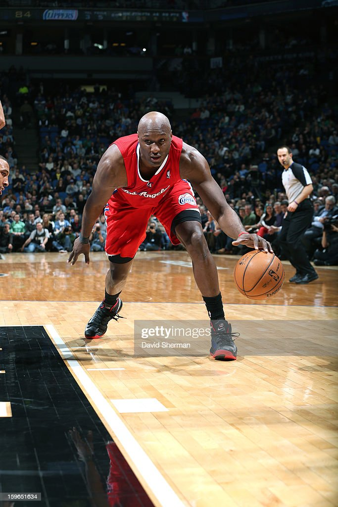 Lamar Odom #7 of the Los Angeles Clippers dribbles the ball low against the Minnesota Timberwolves during the game on January 17, 2013 at Target Center in Minneapolis, Minnesota.
