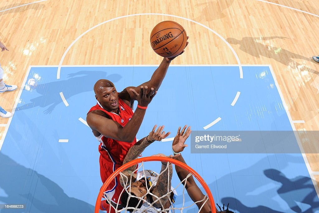 <a gi-track='captionPersonalityLinkClicked' href=/galleries/search?phrase=Lamar+Odom&family=editorial&specificpeople=201519 ng-click='$event.stopPropagation()'>Lamar Odom</a> #7 of the Los Angeles Clippers drives to the basket against the Denver Nuggets on March 7, 2013 at the Pepsi Center in Denver, Colorado.
