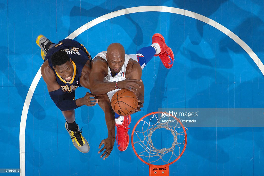<a gi-track='captionPersonalityLinkClicked' href=/galleries/search?phrase=Lamar+Odom&family=editorial&specificpeople=201519 ng-click='$event.stopPropagation()'>Lamar Odom</a> #7 of the Los Angeles Clippers goes to the basket against <a gi-track='captionPersonalityLinkClicked' href=/galleries/search?phrase=Ian+Mahinmi&family=editorial&specificpeople=740196 ng-click='$event.stopPropagation()'>Ian Mahinmi</a> #28 of the Indiana Pacers at Staples Center on April 1, 2013 in Los Angeles, California.