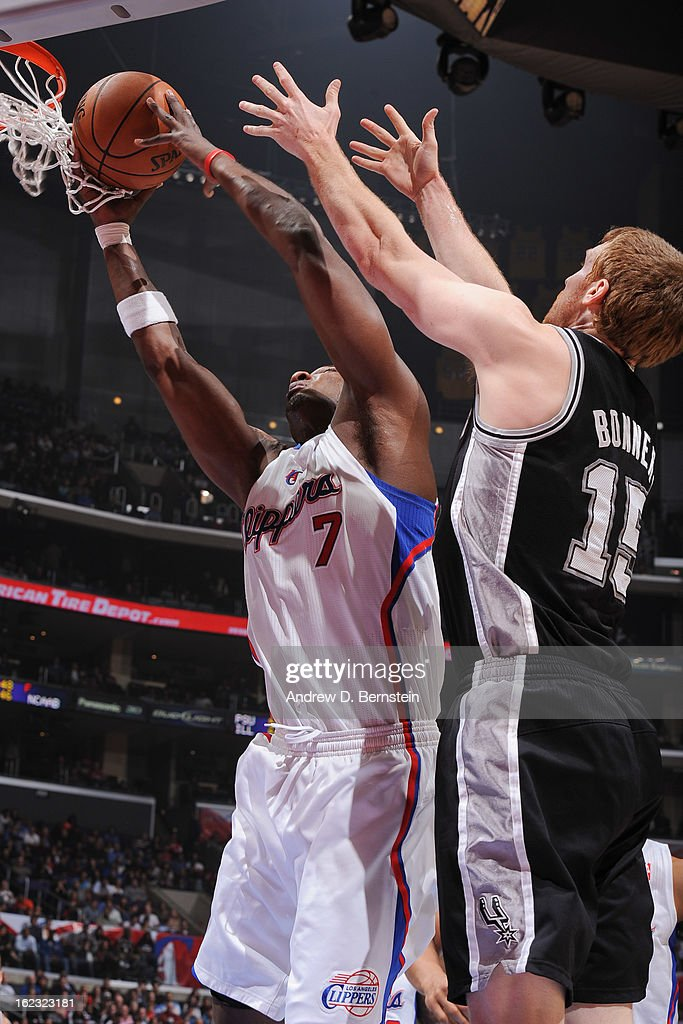 Lamar Odom #7 of the Los Angeles Clippers grabs a rebound against Matt Bonner #15 of the San Antonio Spurs at Staples Center on February 21, 2013 in Los Angeles, California.