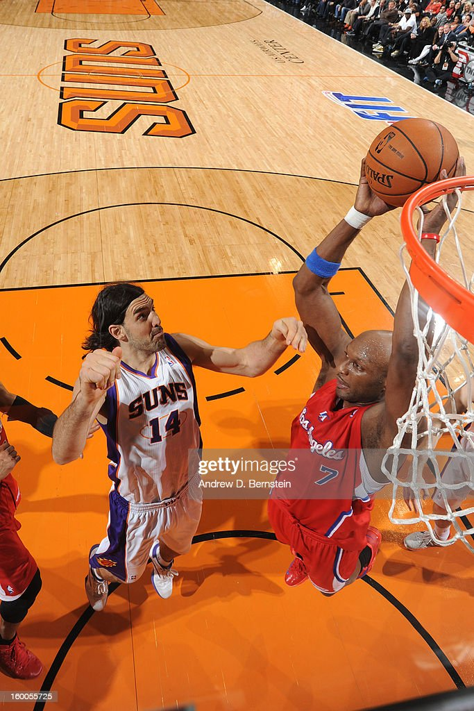 Lamar Odom #7 of the Los Angeles Clippers grabs the rebound against Luis Scola #14 of the Phoenix Suns on January 24, 2013 in Phoenix, Arizona.