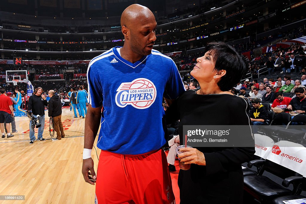 Lamar Odom #7 of the Los Angeles Clippers greets Kris Jenner before the Clippers played the New Orleans Hornets at Staples Center on November 26, 2012 in Los Angeles, California.