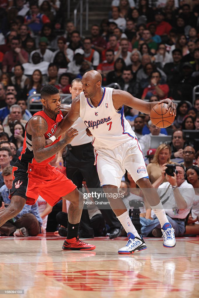 <a gi-track='captionPersonalityLinkClicked' href=/galleries/search?phrase=Lamar+Odom&family=editorial&specificpeople=201519 ng-click='$event.stopPropagation()'>Lamar Odom</a> #7 of the Los Angeles Clippers handles the ball against <a gi-track='captionPersonalityLinkClicked' href=/galleries/search?phrase=Amir+Johnson&family=editorial&specificpeople=556786 ng-click='$event.stopPropagation()'>Amir Johnson</a> #15 of the Toronto Raptors on December 9, 2012 at the Staples Center in Los Angeles, California.