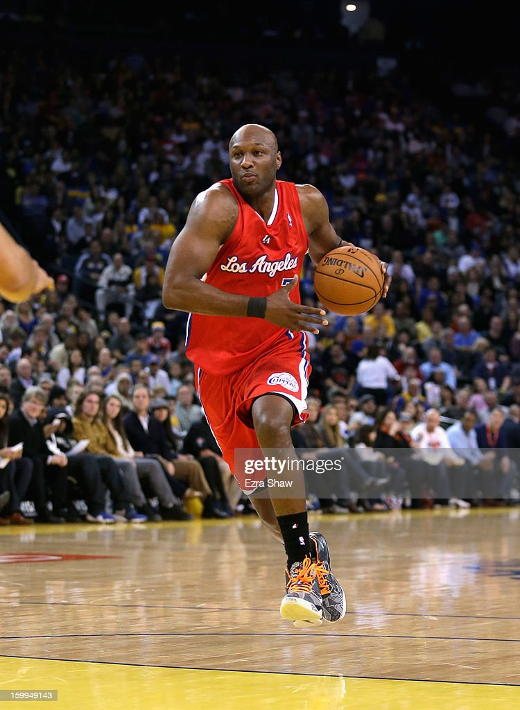 <a gi-track='captionPersonalityLinkClicked' href=/galleries/search?phrase=Lamar+Odom&family=editorial&specificpeople=201519 ng-click='$event.stopPropagation()'>Lamar Odom</a> #7 of the Los Angeles Clippers in action against the Golden State Warriors at Oracle Arena on January 21, 2013 in Oakland, California.