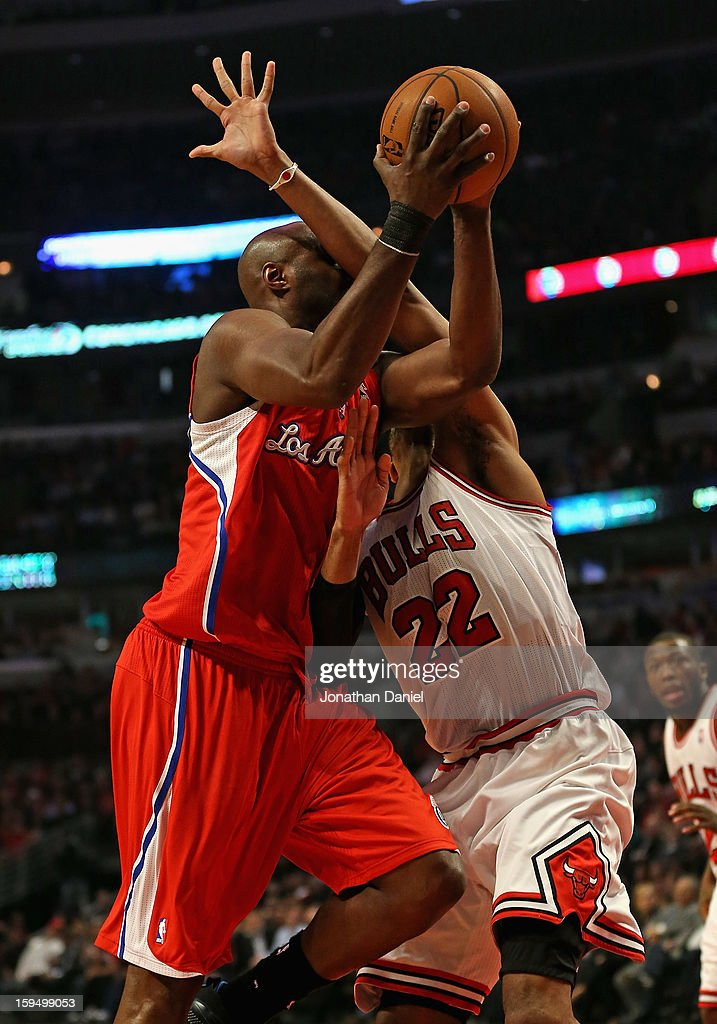 Lamar Odom #7 of the Los Angeles Clippers is fouled by Joakim Noah #13 of the Chicago Bulls at the United Center on December 11, 2012 in Chicago, Illinois. The Clippers defeated the Bulls 94-89.