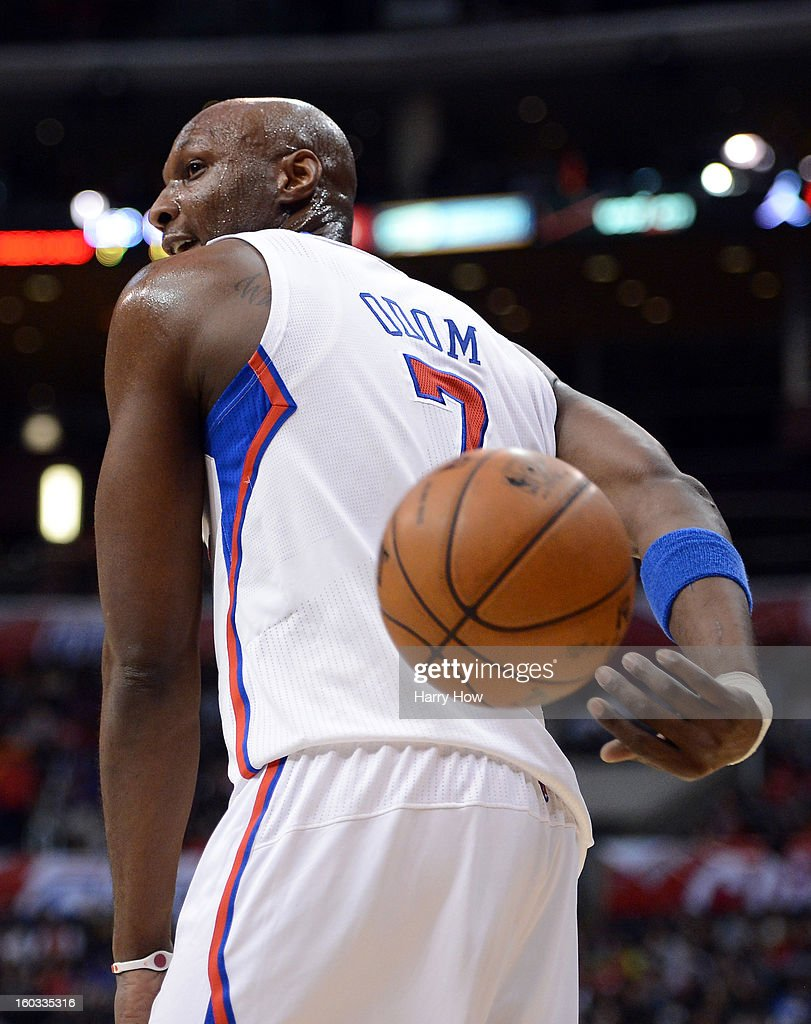 <a gi-track='captionPersonalityLinkClicked' href=/galleries/search?phrase=Lamar+Odom&family=editorial&specificpeople=201519 ng-click='$event.stopPropagation()'>Lamar Odom</a> #7 of the Los Angeles Clippers makes a behind the back pass to the referee after a stop in play at Staples Center on January 27, 2013 in Los Angeles, California.