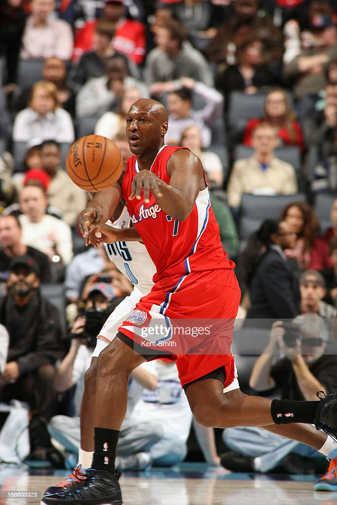 Lamar Odom #7 of the Los Angeles Clippers passes the ball against the Charlotte Bobcats at the Time Warner Cable Arena on December 12, 2012 in Charlotte, North Carolina.