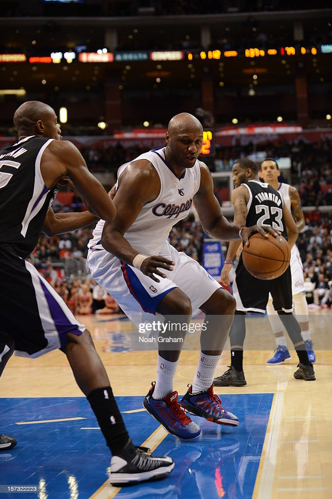 Lamar Odom #7 of the Los Angeles Clippers protects the ball during the game between the Los Angeles Clippers and the Sacramento Kings at Staples Center on December 1, 2012 in Los Angeles, California.