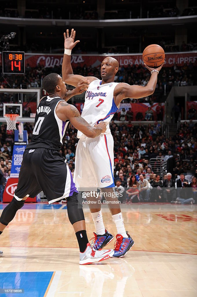 Lamar Odom #7 of the Los Angeles Clippers protects the ball from Thomas Robinson #0 of the Sacramento Kings during the game between the Los Angeles Clippers and the Sacramento Kings at Staples Center on December 1, 2012 in Los Angeles, California.