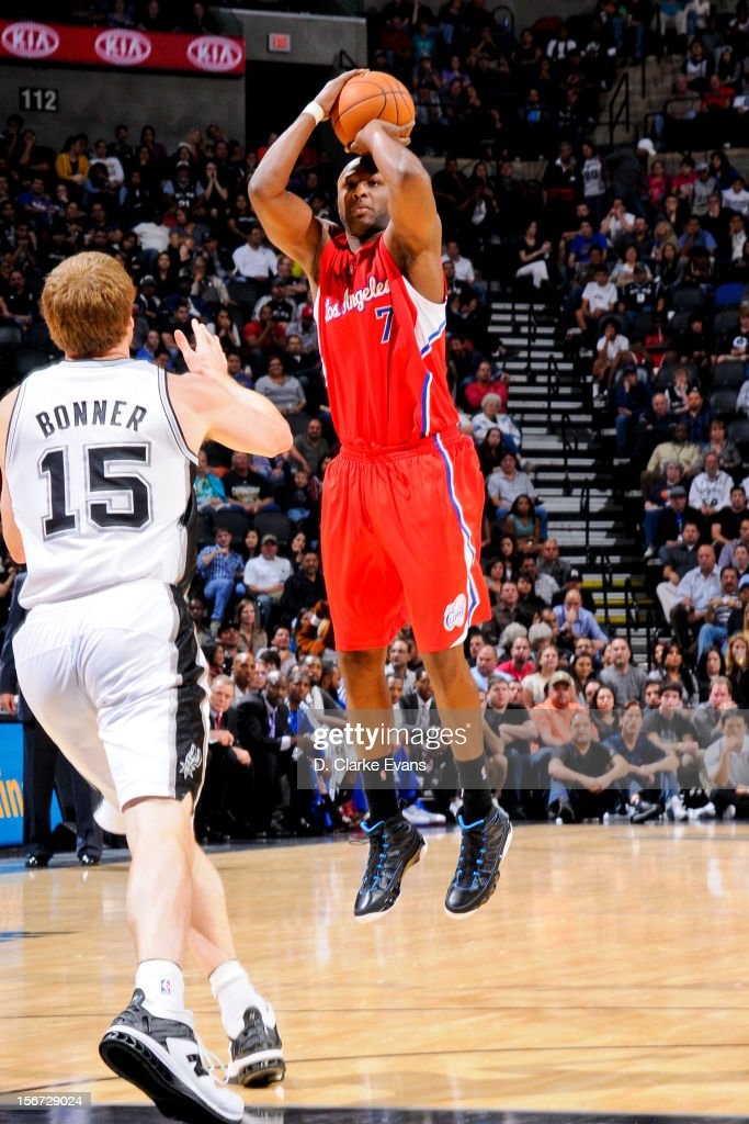 Lamar Odom #7 of the Los Angeles Clippers shoots a three-pointer against Matt Bonner #15 of the San Antonio Spurs on November 19, 2012 at the AT&T Center in San Antonio, Texas.