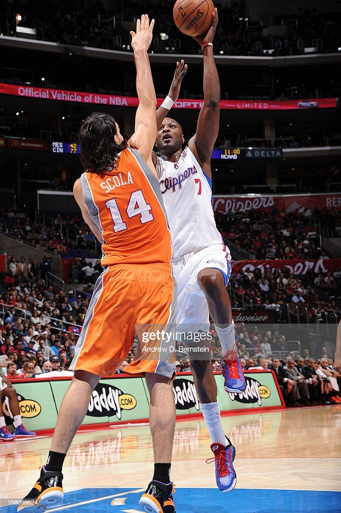 Lamar Odom #7 of the Los Angeles Clippers shoots against Luis Scola #14 of the Phoenix Suns at Staples Center on December 8, 2012 in Los Angeles, California.
