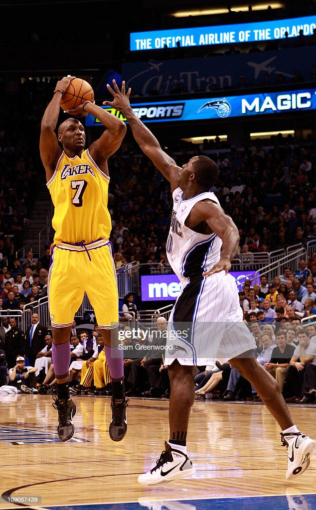 <a gi-track='captionPersonalityLinkClicked' href=/galleries/search?phrase=Lamar+Odom&family=editorial&specificpeople=201519 ng-click='$event.stopPropagation()'>Lamar Odom</a> #7 of the Los Angeles Lakers attempts a shot over <a gi-track='captionPersonalityLinkClicked' href=/galleries/search?phrase=Brandon+Bass&family=editorial&specificpeople=233806 ng-click='$event.stopPropagation()'>Brandon Bass</a> #30 of the Orlando Magic during the game at Amway Arena on February 13, 2011 in Orlando, Florida.