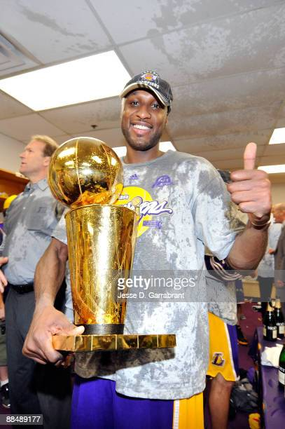 Lamar Odom of the Los Angeles Lakers celebrates with the Larry O'Brien Championship trophy after the Lakers won 9986 to win the NBA Championship...