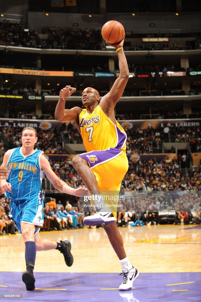 Lamar Odom #7 of the Los Angeles Lakers goes up for a dunk against the New Orleans Hornets at Staples Center on December 1, 2009 in Los Angeles, California.