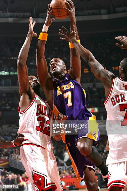 Lamar Odom of the Los Angeles Lakers is fouled driving to the basket against Joe Smith and Ben Gordon of the Chicago Bulls on December 18 2007 at the...