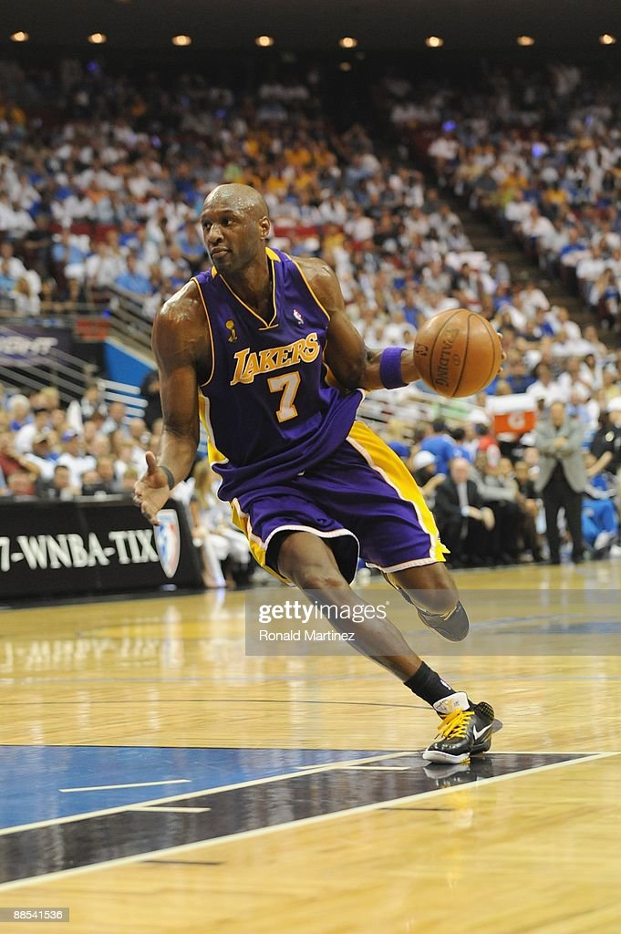 Lamar Odom #7 of the Los Angeles Lakers moves the ball against the Orlando Magic in Game Five of the 2009 NBA Finals on June 14, 2009 at Amway Arena in Orlando, Florida. The Lakers won 99-86.