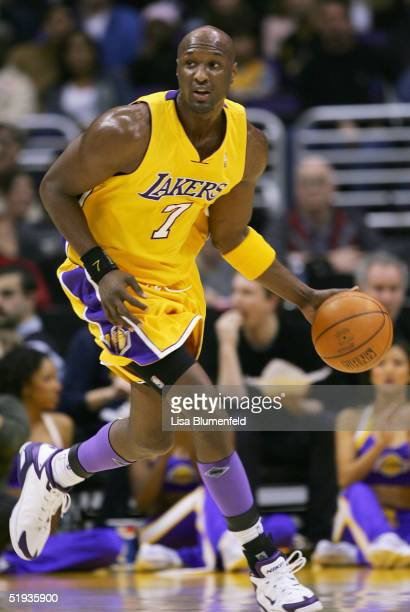 Lamar Odom of the Los Angeles Lakers moves the ball upcourt during the game against the Toronto Raptors on December 28 2004 at Staples Center in Los...
