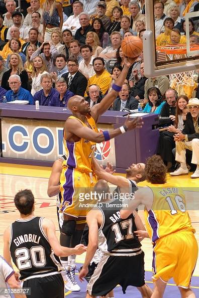 Lamar Odom of the Los Angeles Lakers shoots a layup over Manu Ginobili Brent Barry and Tony Parker of the San Antonio Spurs in Game Five of the...