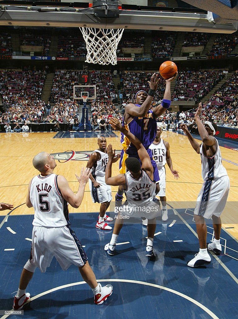 6ce2c643a ... Jersey Nets on Lamar Odom 7 of the Los Angeles Lakers shoots against  Jason Collins 35 of ...