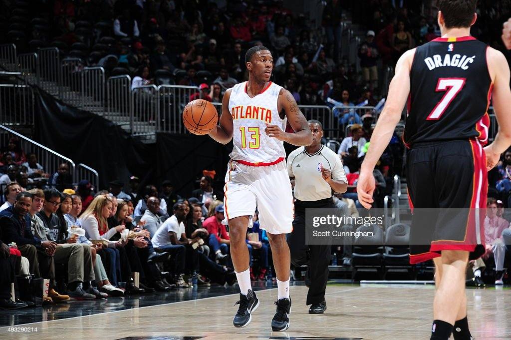 <a gi-track='captionPersonalityLinkClicked' href=/galleries/search?phrase=Lamar+Patterson&family=editorial&specificpeople=6480704 ng-click='$event.stopPropagation()'>Lamar Patterson</a> #13 of the Atlanta Hawks brings the ball up court against the Miami Heat on October 18, 2015 at Philips Arena in Atlanta, Georgia.