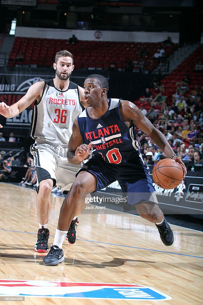 <a gi-track='captionPersonalityLinkClicked' href=/galleries/search?phrase=Lamar+Patterson&family=editorial&specificpeople=6480704 ng-click='$event.stopPropagation()'>Lamar Patterson</a> #10 of the Atlanta Hawks handles the ball against the Houston Rockets during the Samsung NBA Summer League 2014 on July 19, 2014 at the Cox Pavilion in Las Vegas, Nevada.