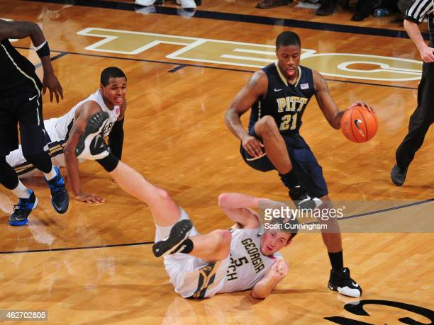 Lamar Patterson of the Pittsburgh Panthers drives against Daniel Miller of the Georgia Tech Yellow Jackets at McCamish Pavilion on January 14 2014 in...