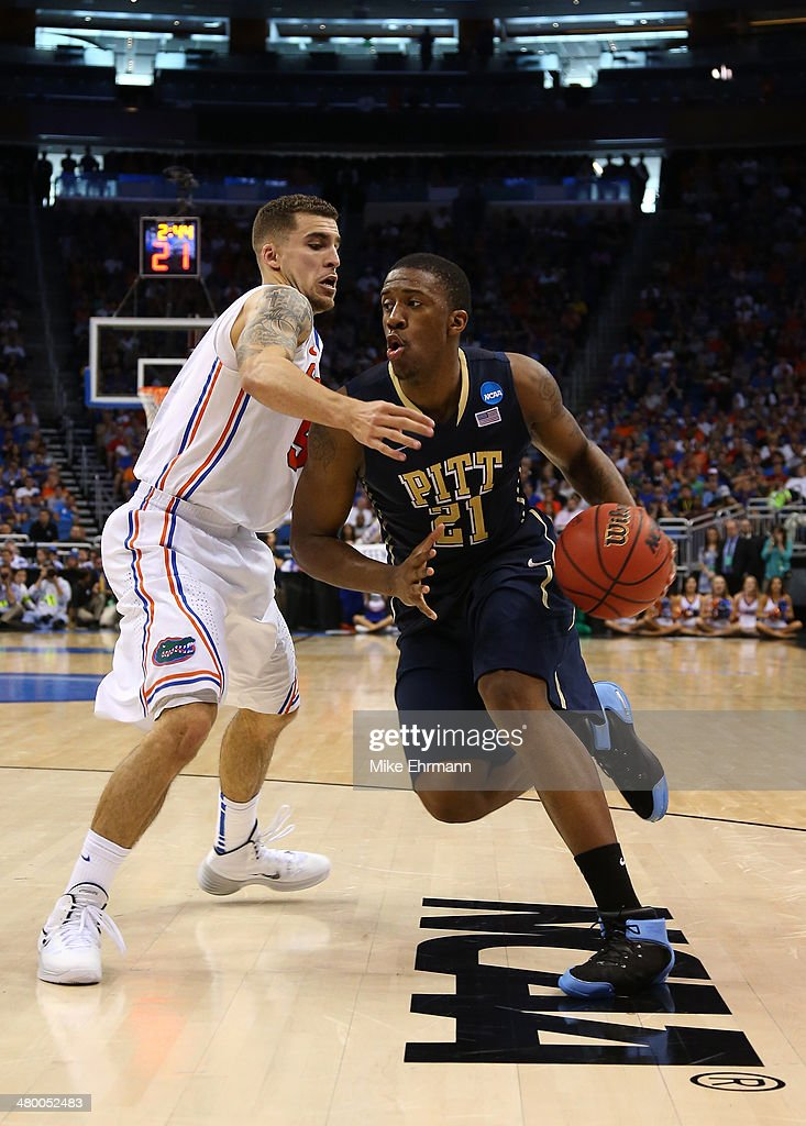 Lamar Patterson of the Pittsburgh Panthers drives on Scottie Wilbekin of the Florida Gators in the second half during the third round of the 2014...