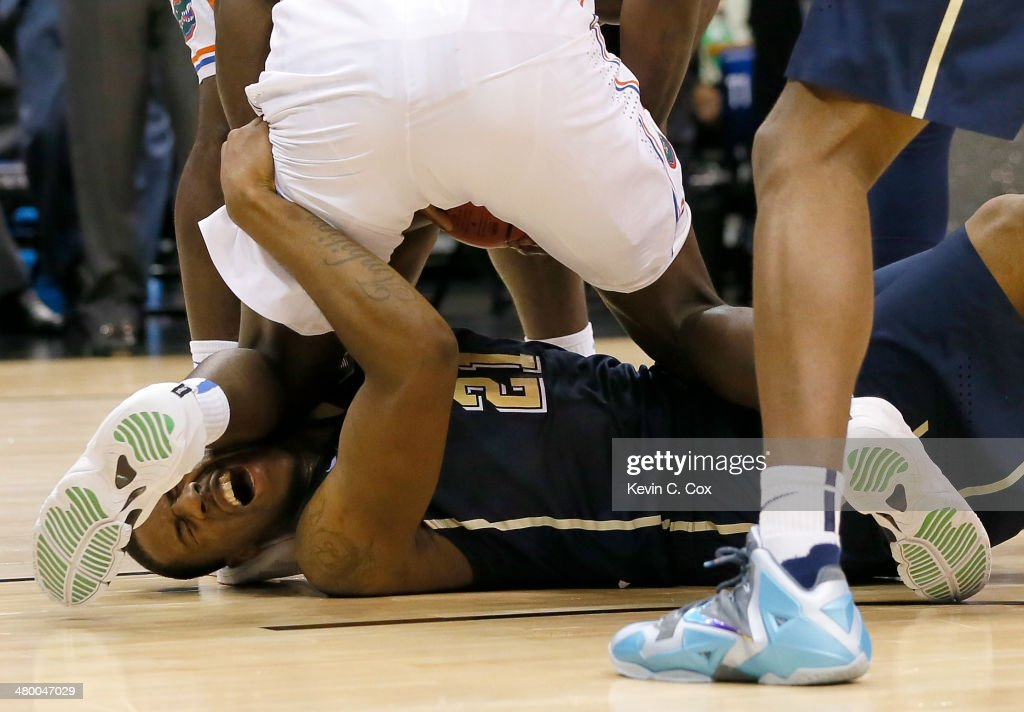 <a gi-track='captionPersonalityLinkClicked' href=/galleries/search?phrase=Lamar+Patterson&family=editorial&specificpeople=6480704 ng-click='$event.stopPropagation()'>Lamar Patterson</a> #21 of the Pittsburgh Panthers with the ball against Dorian Finney-Smith #10 of the Florida Gators in the first half during the third round of the 2014 NCAA Men's Basketball Tournament at Amway Center on March 22, 2014 in Orlando, Florida.