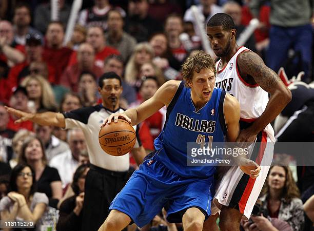 LaMarcus Aldrdige of the Portland Trail Blazers defends Dirk Nowitzki of the Dallas Mavericks in Game Four of the Western Conference Quarterfinals in...