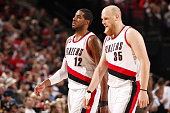LaMarcus Aldridge and Chris Kaman of the Portland Trail Blazers during the game against the Denver Nuggets on March 28 2015 at the Moda Center in...