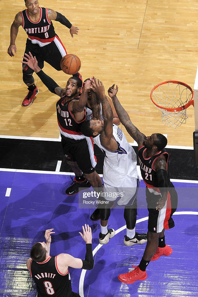 <a gi-track='captionPersonalityLinkClicked' href=/galleries/search?phrase=LaMarcus+Aldridge&family=editorial&specificpeople=453277 ng-click='$event.stopPropagation()'>LaMarcus Aldridge</a> #12 and <a gi-track='captionPersonalityLinkClicked' href=/galleries/search?phrase=J.J.+Hickson&family=editorial&specificpeople=4226173 ng-click='$event.stopPropagation()'>J.J. Hickson</a> #21 of the Portland Trail Blazers fight off Thomas Robinson #0 of the Sacramento Kings for the rebound on December 23, 2012 at Sleep Train Arena in Sacramento, California.